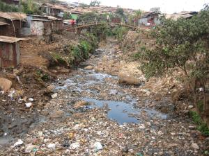 Photo: Dara Lipton/The Advocacy Project - A stream in the Kibera slum is used as a dump site for trash and human waste