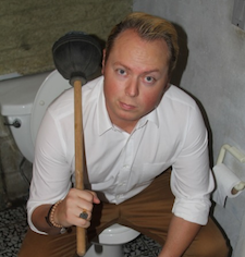 John Kluge, A Committed Toilet Hacker
