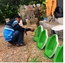 Coloured cement pans produced by local artisans for the SHAW programme in West Timor, Indonesia