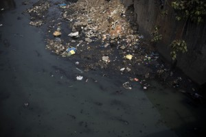 Polluted water runs through a sewer in the Dharavi slum area of Mumbai, India. Only 26 percent of the 6 billion gallons of sewage generated daily in India is treated.