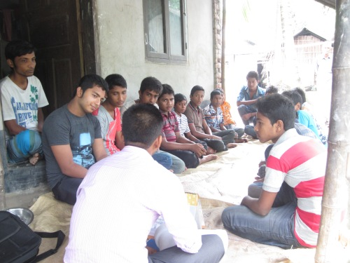 Cluster meeting in the community with adolescent boys