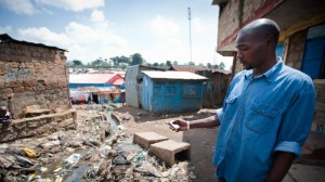 In an undated photo, Thuo Wanjiku, a data collector with Spatial Collective, collects mapping data via mobile phone in Nairobi's Mathare slum. Photo by Rick Roxburgh/Spatial Collective