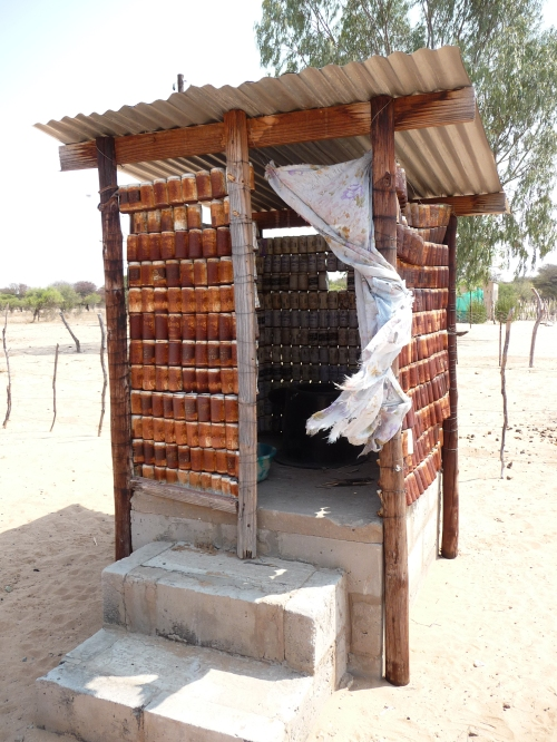 Urine-diverting dry toilet (UDDT) with walls made of old beer cans (Botswana).  Photo: Stefanie Lorenz, Sept 2009