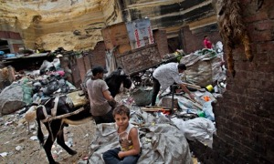 A family at work in the Mokattam area of the Egyptian capital Cairo, where zabaleen collect, separate, sell or reuse rubbish. Photograph: Bernat Armangue/AP