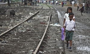 A slum in India: for want of basic sanitation children often defecate near the railway tracks. Photograph: Jon Spaull/WaterAid