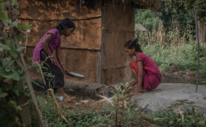Radha Bishwa Karma serving food behind the toilet. Credit: WaterAid/Poulomi Basu