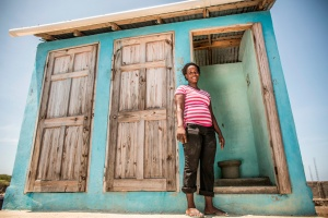 Alcime, 28, in front of her community toilet. Cap-HaÏtien, Haiti. Photo: Shiho Fukada, Panos pictures for WSUP, Assisted by International Medical Corps UK.