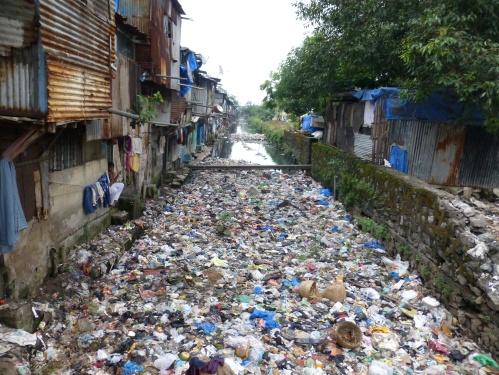 Convergence of human and solid waste in a stormwater drain in Mumbai, India (Photo by Giacomo Galli/ IRC).