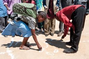 CLTS triggering in a village in Tanzania. Photo: Jenny Matthews/WSSCC