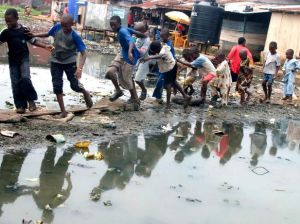 Children play at a slum in Ijegun Egba, a suburb of Nigeria's commercial capital of Lagos, July 2, 2008. (Courtesy Reuters/George Esiri)