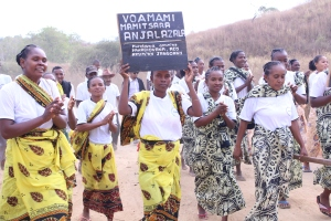 Photo: Members of a local sanitation and hygiene advocacy group in the fokontany of Anjalazala celebrate achieving open defecation free status. Credit: FAA/Nirina Roméo Andriamparany