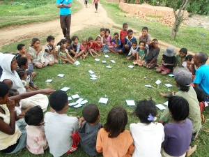 Photo: 'Triggering' children in the commune of Mangarano, using the open defecation mapping tool. Credit: FAA/Fano Randriamanantsoa