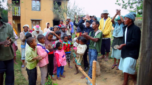 A community celebrating the creation of their 'model latrine' for others to replicate during a FUM session in Madagascar. Credit: WSSCC