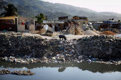 People dump trash and raw sewage into canals that run through Port-au-Prince, Haiti. When it rains, the canals overflow and flood poor neighborhoods. John W. Poole/NPR
