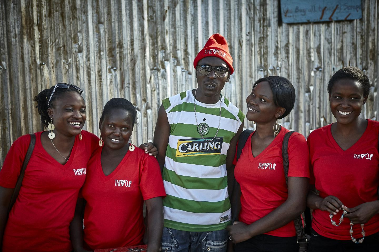 Joshua Omanya, center, is an educator with The Cup program who teaches boys in the Kibera slum in Nairobi, Kenya, about menstruation and gender equality.